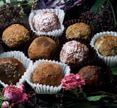Made by hands raw candy with nuts, figs and truffles and kupoy, healthy food