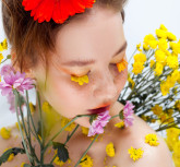 Beautiful young girl in the image of flora, close-up