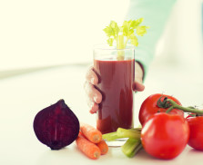 healthy eating, food, dieting and people concept - close up of woman hands with tomato juice and vegetables