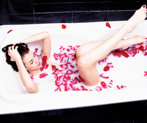Girl in bath of milk with rose petals